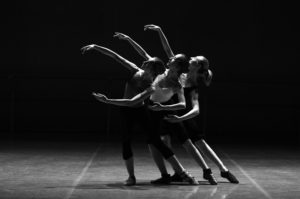 3 dancers showing movement